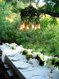 Position dinner tables under tree canopies at outdoor receptions to creatively take advantage of the branches. Would be much easier to make a similar chandelier with Candle Impressions Flameless Candles, instead of worrying about wiring.