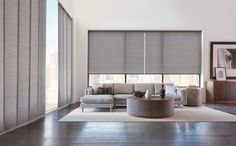 Skyline® Gliding Window Panels and Designer Roller Shades - made from the same materials - add drama to this living room. Living Tv, Condo Living Room, Big Living Rooms, Living Room Grey, Living Room Modern, Living Room Designs, Modern Living Room Curtains, Blinds For Windows Living Rooms, House Blinds