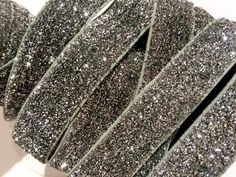 "Gray 5/8"" frosted glitter elastic. For making baby headbands, barefoot baby sandals, sewing & more. FOE, shabby rose trim, jewelry findings & more also available!"