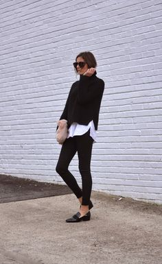 sleek and chic outfit. black cigarette pants, white button down, black turtleneck. simple clutch and flats.