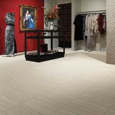 Photo features Bianco 12 x 24 field tile in a grid pattern on the floor. Left wall features Color Wave Red Hot 2 x 12 liner in a vertical staggered brick-joint pattern. Right wall features 3 x 3 Baroque Mosaic Polished in Crema Marfil Classico Marble.