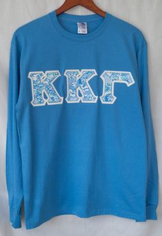 Columbia long sleeve t-shirt featuring the Kappa Kappa Gamma Lilly Pulitzer fabric, on glitter backing.