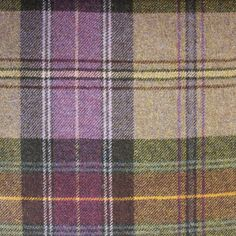 Beachcomber Tartan Fabric A pure wool tartan fabric woven in purple, lilac, aubergine and yellow.