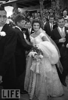 Sept. 12, 1953: Wearing her grandmother's rose-point lace veil, 24-year-old Jacqueline Lee Bouvier is the picture of perfection on the day of her wedding to Sen. John Fitzgerald Kennedy.