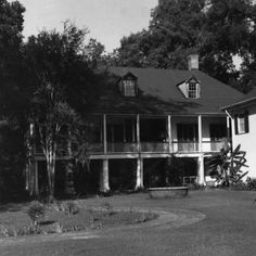 Rear of Parlange plantation home in New Roads Louisiana in the 1970s :: State Library of Louisiana Historic Photograph Collection
