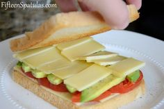 This opening photo...was it the most put-together shot I had? ...no. But I think it captures the glory that is this sandwich. Gooey gruyere cheese smashed between thick slices of buttery avocado and heirloom tomato, and