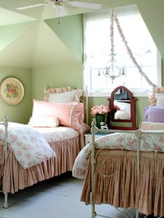 Romantic frills   Give a guest room a feminine touch with a pink-and-white scheme. Decorate with cottage roses, flea market finds and green accents. Twin beds tuck under the eaves, creating a cozy space. Pretty rose comforters, checkered quilts and ruffled shams pile on the comfort. An antique chandelier hanging between the beds sweetly completes the space.