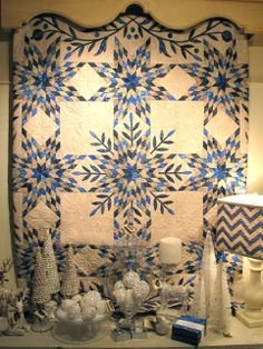 Love the icy, coldness of this quilt and décor.  Looks like January and Feb.