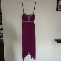 Dress Purple strappy dress. Dress goes past knees. Nice summer weeding type of dress. Slip underneath. Only worn once! 100% polyester. Dresses