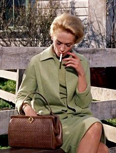"Tippi Hedren having a smoke outside the school in Hitchcock's excellent ""The Birds."" Great actress underrated and undermined."