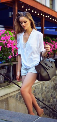 Kristina Bazan is wearing a top from Zara, short shorts from Zara, shoes from Alexander Wang and a bag from Céline