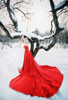 You should always have a gorgeous dress for your senior pictures! The red is a great color pop for snow!