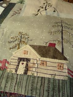 appliqued house- a more literal log cabin, maybe for the center of a log cabin block quilt?