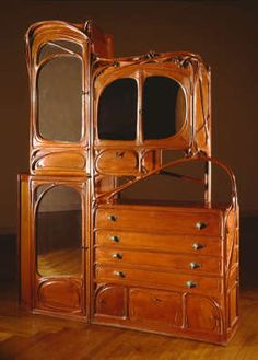 "Guimard, Hector (artist)  Cabinet from Castel Béranger  20th century, 1899   Furniture, Pear, ash, bronze, mirrored glass  Height: 117""; Width: 93 1/2""; Depth: 19 1/2""  Virginia Museum of Fine Arts"