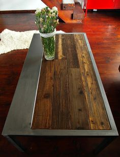 Industrial vintage style coffee table, made from reclaimed wood and steel thats over 100 years old. A solid and soulful piece of organic furniture that has been lovingly handcrafted using the finest reclaimed materials. The wood used in the piece is pine, a fantastic soft wood perfect for furniture building due to its malleable yet long lasting properties. To prolong the condition of the wood further the pine has been protected with wax. The steel has been painted with acrylic lacquer to…