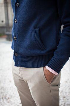 Navy cardigan sweater, pink shirt, khakis