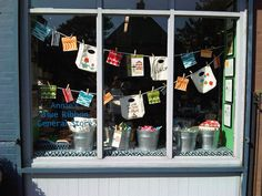 Back to School windows. Love the galvanized buckets and clothesline.
