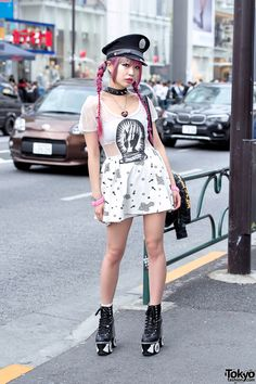 Harajuku monster girl Asachill on the street wearing a sheer dress from Glad News with a UNIF flames backpack and roller skate platform heels by Sretsis.