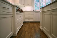 Classic white kitchen by Walker Woodworking. This open classic white kitchen allows plenty of light to reflect off the white custom cabinets. Inset Cabinets, Custom Cabinets, Kitchen Cabinets, Organizing Ideas, Home Organization, Classic White Kitchen, Closet Office, Drop Zone, Desk Areas