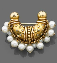 A brooch by René Boivin, circa 1935. Designed as an arch, highlighted with rose-cut diamonds, suspending numerous cultured pearls. #Vintage #Boivin #brooch