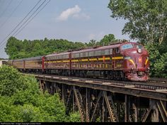 Juniata Terminal Company's beautifully restored Pennsylvania Railroad E8s cross the Yadkin River bridge south of Linwood Yard as they finish their run to Spencer.