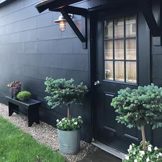 "AnnieMost Lovely Things (@most_lovely_things) on Instagram: ""Our black garage and backyard transformation was featured on the blog of @barnlightelectric today!…"""