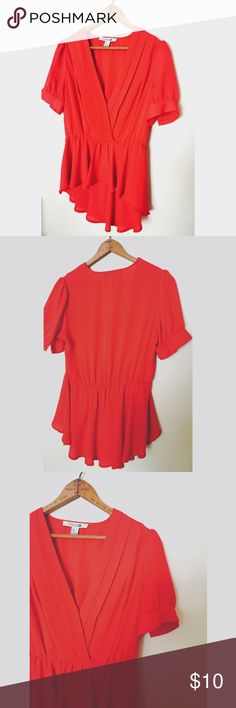 Forever 21 Red Blouse Beautiful red Blouse that has a deep vibe know and a peplum like bottom.  Very flowy and in perfect condition! The color is a bright deep red Forever 21 Tops Blouses