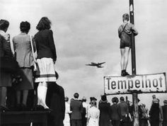 Germans watch as American planes bring supplies to West Berlin during the Berlin Airlift