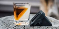 """Grasp in the advantages of """"on the rocks"""" without watering down your favorite spirits on this Whiskey Wedge by Corkcicle. The set includes one Double-Old Fashioned Whiskey Glass and one silicone mold which when paired together gives your liquor that. Whisky, Unique Gifts For Him, Ice Molds, Wine Chiller, Old Fashioned Glass, Bar Accessories, Liquor, The Help, Barware"""
