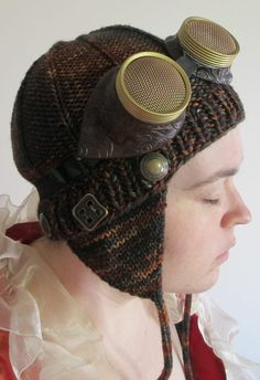 Free Knitting Pattern for Aviator Hat Steampunk Style - Perfect for Aeronauts! Veronica O'Neil's aviator style hat features ridges, ear flaps and button embellishments. Pictured project by kolorswkrayons