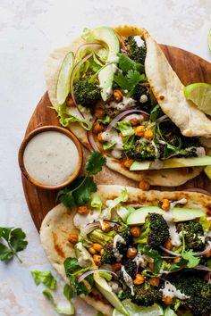 Buffalo Broccoli and Chickpea Pitas with Tahini Caesar #vegetarianrecipes #healthyrecipes #vegan #buffalo #tahini