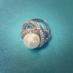 Super cute ring. Large pearl set in rhinestones. Super cute chunky pearl ring. Pearl is set in a silver setting with rhinestones.  Jewelry Rings