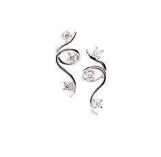 FORME COLLECTION - Italian Handmade 18K White Gold Diamond Earrings with 6 solitaire Diamonds.The dainty and contemporary creations appear in spiral gold lines in each setting, creating an elegant artistic design. (Diamond Clarity: VSI1 - Color:F)