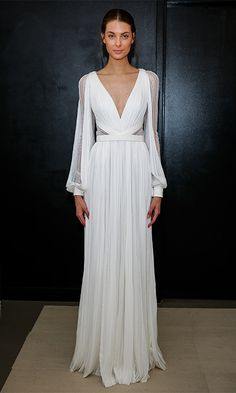 How would the look translate for a walk down the aisle in warm-weathered Mexico, where Eva is set to wed? Transparent sleeves and side panels give a peek-a-book effect to this light and floaty long-sleeved look by J. Mendel.