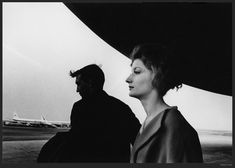 Photo by Robert Frank.I like the mystery of the man in the background and the longings on the women face