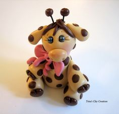 """This adorable little Giraffe Cake Topper is perfect for a baby shower, or would make a wonderful shower gift! She sits approximately 2 1/4"""" high, 1 3/4"""" wide and 1 3/4"""" long."""