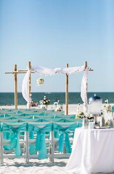 Blue chair ribbon decor for beach wedding, 2014 beach wedding chair decoration www.loveitsomuch.com