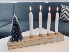 modern minimalist Advent wreath made of oak and copper plus table candle white and mini fir candle holder wood