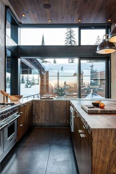 Rustic alpine ranchiness - slab wood kitchen with incredible view of trees