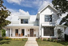 White farmhouse with board and batten exterior and metal roof. White farmhouse with board and batten exterior and metal roof. J Taylor Designs Future House, My House, Modern Farmhouse Exterior, Farmhouse Design, Farmhouse Windows, Farmhouse Front, Industrial Farmhouse, Vintage Farmhouse, Farmhouse Addition