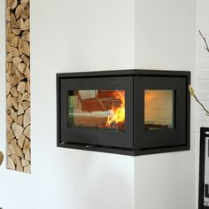 The Rais 500/2 with glass on two sides makes a unique corner fireplace. #kernowfires #wadebridge #redruth #cornwall #rais #stove #fire #wood #burner #inset #modern #contemporary #two #sided