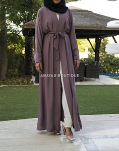 This classic minx colour kimono inspired open abaya has to be a firm favourite this season. Can be easily styled from day to night with a change of accessories.