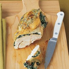 Chicken Breasts Stuffed with Spinach and Ricotta Recipe Main Dishes with frozen chopped spinach, ricotta cheese, garlic, coarse salt, ground pepper, bone-in chicken breasts, plum tomatoes