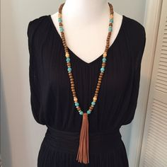 Boho beaded vegan tassel necklace Long gold,brown and turquoise beaded necklace with faux leather tassel. New,never worn. Gold adjustable clasp closure. NO TRADES Jewelry Necklaces