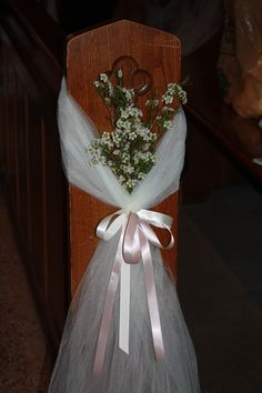 Posno Florist did our flowers ,this is Wax Flowers  and my daughter did in tulle with ribbon