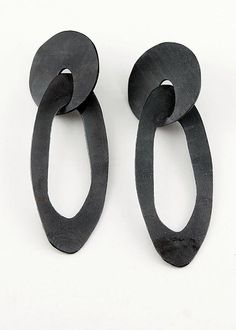 Drop Earrings by Maia Leppo: Steel Earrings available at www.artfulhome.com Bold Earrings with an industrial edge catch the eye with unexpected nuances. Laser-cut carbon steel is fabricated and finished by hand, then heat-treated and sealed with olive oil.