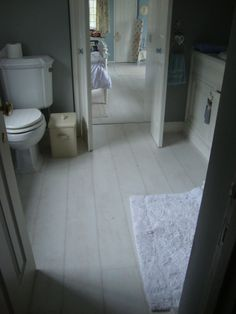 white bathroom laminate flooring simple contemporary bathroom with rubber laminate flooring 21432