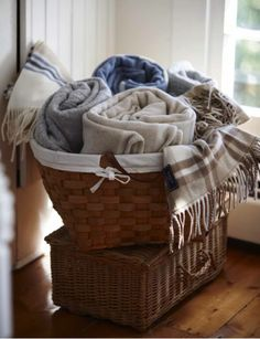 Basket of blankets ~ I love my blankets in my basket in the family room! So Cozy Blanket Basket, Vibeke Design, Fontainebleau, New England Style, Cozy Blankets, Winter Blankets, Cozy House, Home Staging, Warm And Cozy