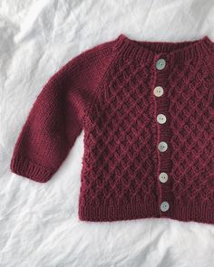 Carl's Cardigan 🍇 A smock knit cardigan from the gems revived with mother of pearl butto Baby Booties Free Pattern, Baby Cardigan Knitting Pattern, Baby Knitting Patterns, Baby Patterns, Baby Boy Cardigan, Knitted Baby Cardigan, Hand Knitted Sweaters, Crochet Baby, Knit Crochet
