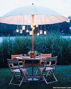 Hanging a set of miniature glass lanterns from your patio umbrella not only creates the effect of a magical chandelier, it also makes more table space for an inventively placed centerpiece.